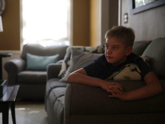 Jacob Stadler watches TV before breakfast at his Appleton