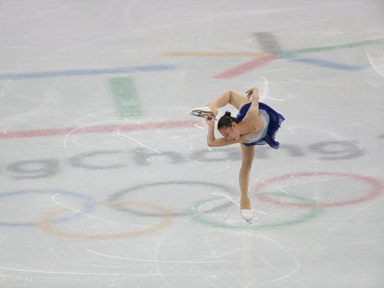 Xiangning Li of China  competes in the Figure Skating-Team-Women's