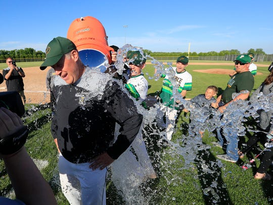 Green Bay Preble coach Andy Conard gets an ice water bath after his team's win against Antigo in a WIAA baseball sectional final June 5.