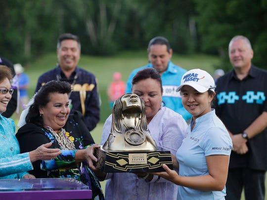 Sei Young Kim of South Korea is presented with the trophy after winning the Thornberry Creek LPGA Classic on July 8, 2018, in Hobart.