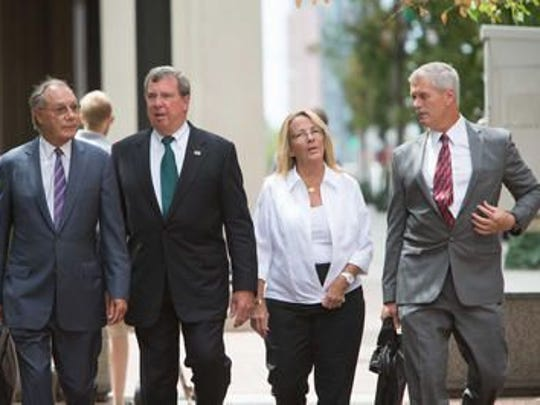 Wilmington Attorney Michael Kelly (far right) walks alongside clients in the Wilmington Trust Case.