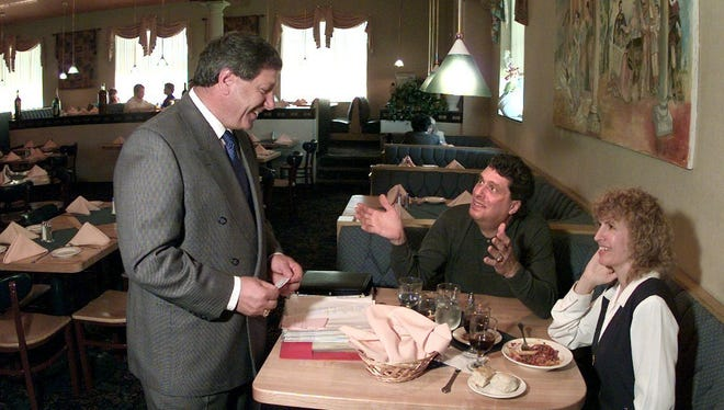 -  Mario Daniele (L) chats with diners Peter Finch and Ruth Rosenberg-Naparsteck at Mario's Via Abruzzi in this file photo from 1997.