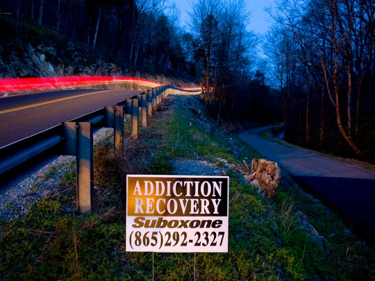 An addiction recovery sign stands beside a road in LaFollette, Tenn., in 2018. In 2015, Campbell County had the third-highest amount of opioids prescribed per person among all U.S. counties, according to the Centers for Disease Control and Prevention.