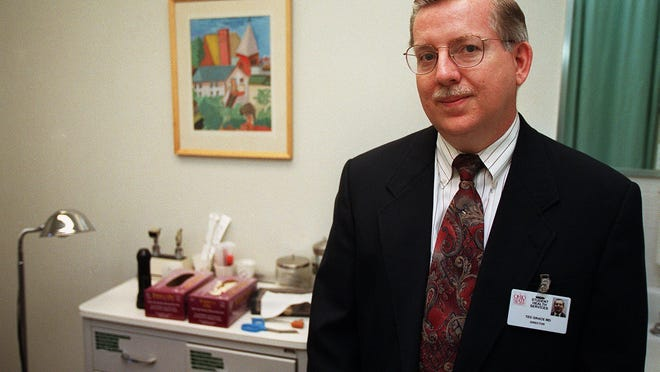 Ted Grace is pictured in an examination room at the student health services building in 1998. He's now employed by Southern Illinois University.
