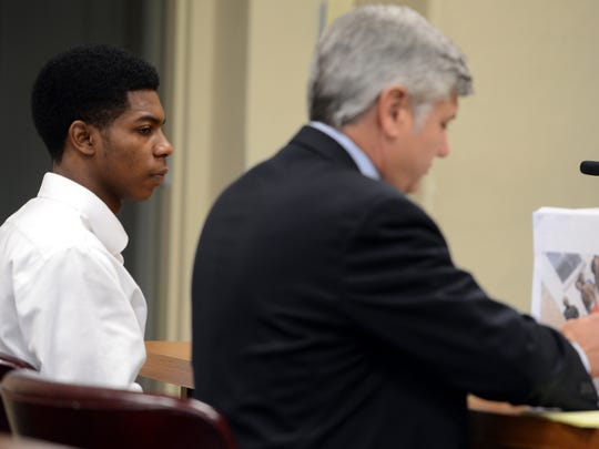 Jernigel Blackwell sits with his attorney, Joseph Howell, during a transfer hearing in Madison County Juvenile Court on Wednesday. Blackwell is charged with first-degree murder of Shomari Peterson and attempted first-degree murder of Thomas Reid.