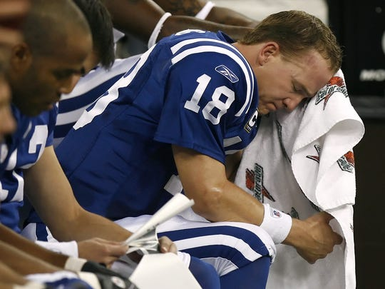 Peyton Manning couldn't even watch during the final moments.
