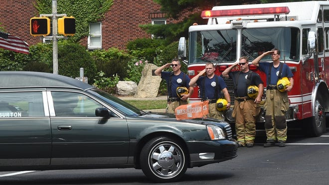 Firefighters, from left, John Fatter, Mike Hodak, Scott Taylor and Rick Swaney, of Engine Co. 11, salute as the funeral procession for La'Myhia Jones, 8; Luther Jones Jr., 6; Ava Jones, 4; and Jaydan Augustyniak, 9 months, passes the intersection of West 8th Street and Bayfront Parkway, en route to the Erie, Pa., Cemetery following a funeral ceremony at the Bayfront Convention Center on Saturday, Aug. 17, 2019. The children died, along with 2-year-old Dalvin Pacley, when a fire broke out at the Harris Family Daycare at 1248 W. 11th St. shortly after 1 a.m. on Aug. 11. The crew from Engine Co. 11 was first on the scene the night of the fatal fire. (Jack Hanrahan/Erie Times-News via AP)