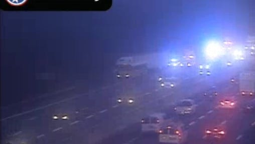 Interstate 24 east traffic camera shows crash between school bus and semi.