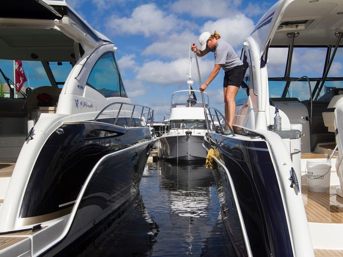 Jennifer Marsh washes a boat at the Fort Myers Yacht