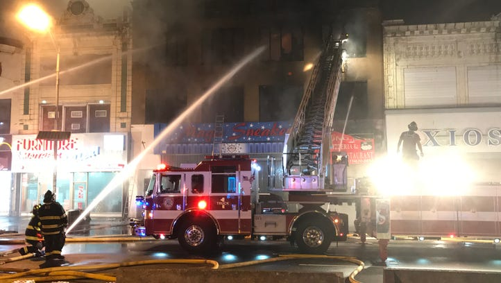Firefighters battle a four-alarm blaze that sparked