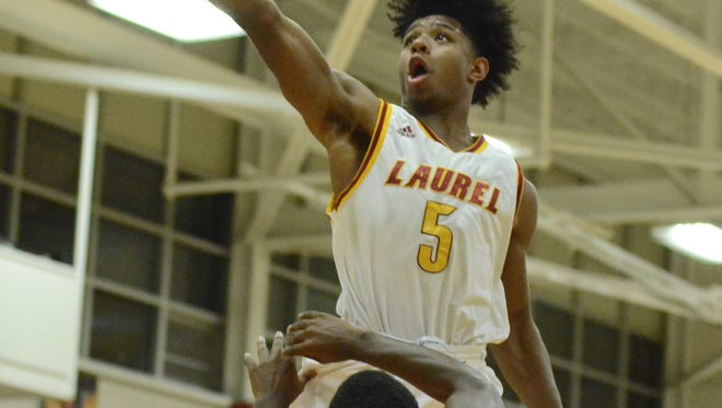 Laurel's Dontario Drummond (5) goes up for a layup in Saturday's game against West Harrison.