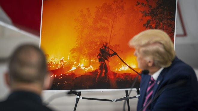 President Donald Trump is shown in September taking part in a briefing on wildfires at the Sacramento McClellan Airport in McClellan Park, Calif.