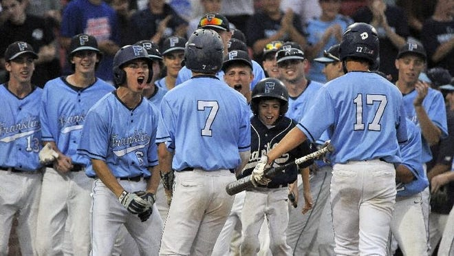 Franklin players welcome Jake Macchi (7) back to the bench after he hit a home run in the first inning of the Panthers' 3-2 win over Central Catholic in the championship round of the Division 1A state tournament at Campanelli Stadium in Brockton in 2018.