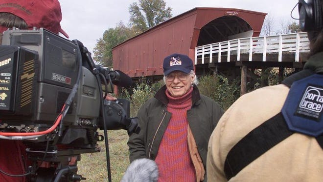 """Author Robert James Waller was in Madison County in October 2002 to tape a segment for the Travel Channel about visiting places that have a connection to movies. The local production crew taped Waller at the Roseman Bridge and in the town of Winterset, locations from the movie """"The Bridges of Madison County."""""""