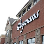 The Wegmans supermarket on East Avenue. Top-ranked chain is celebrating 100 years.