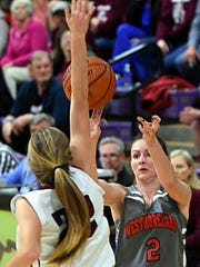 Westmoreland High senior guard Haley Braswell releases a first-half 3-pointer over the outstretched arm of Cheatham County's Macy Douglas. Braswell scored six points.