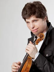 """Violinist Augustin Hadelich will join the Oregon Symphony for a concert at 8 p.m. April 8 at Willamette University's Smith Auditorium. The concert features a mix of classical and modern music including Adés' Violin Concerto """"Concentric Paths."""""""
