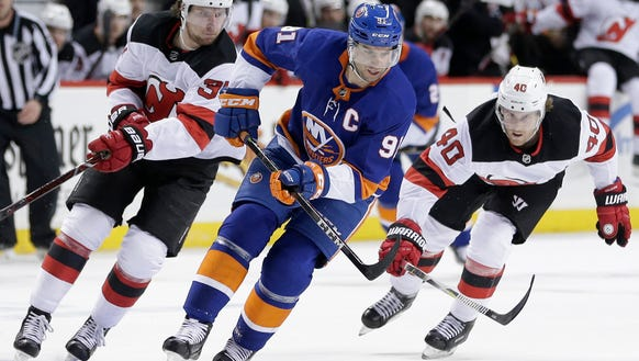 New York Islanders' John Tavares moves the puck downice