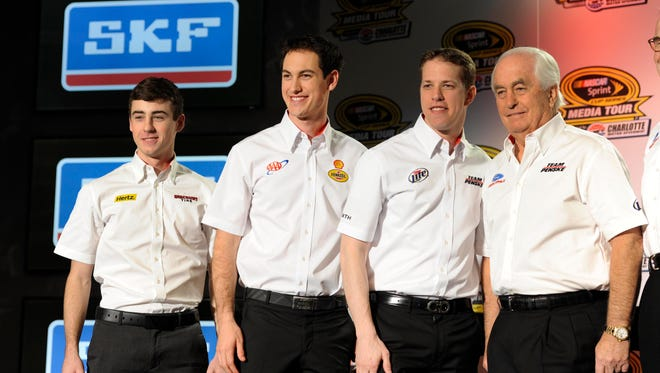 Team Penske president Tim Cindric, not shown, believes the organization owned by Roger Penske, right, will eventually have to expand beyond drivers Joey Logano, left, and Brad Keselowski, center.