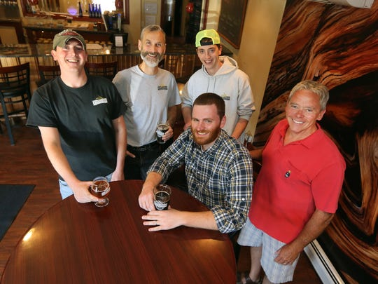 In a collaboration effort Collin McConville (seated) of Apple Country Spirits, joins with Knucklehead Brewery's  Jake Dummer, George Cline, Josh Dummer and Len Dummer in creating  a new barrel-aged product.