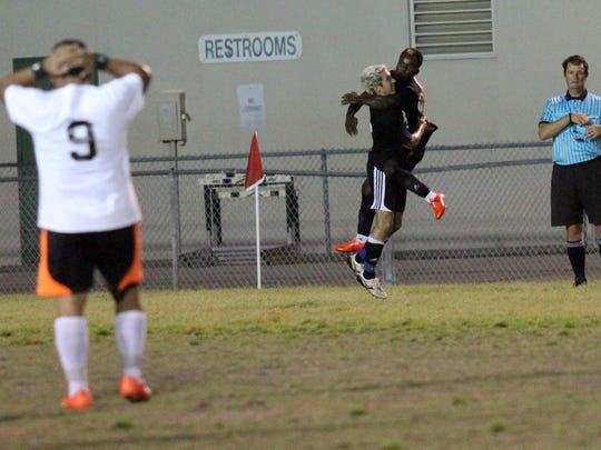 Ray Gerke and Speedoh Basquin celebrate a goal during Wednesday night's Southwest Florida Senior Soccer Bowl at Fort Myers High School.