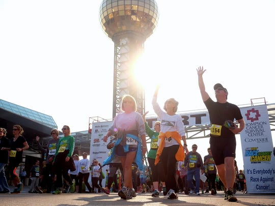 Runners make their start during the SUBWAY Race Against Cancer 5K in support of Thompson Cancer Survival Center on Sunday, Nov. 13, 2016, at the World's Fair Park.  (Shawn Millsaps/Special to News Sentinel)