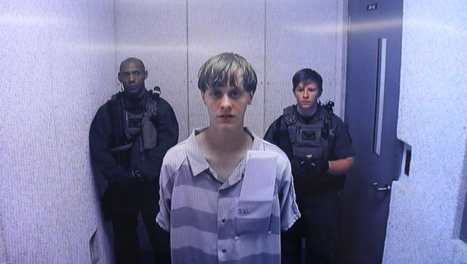 In a video uplink from the detention center to the courtroom, Dylann Roof appears at Centralized Bond Hearing Court, June 19, 2015, in North Charleston, S.C.