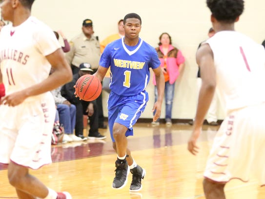 Westview's B.J. White brings the ball down the court