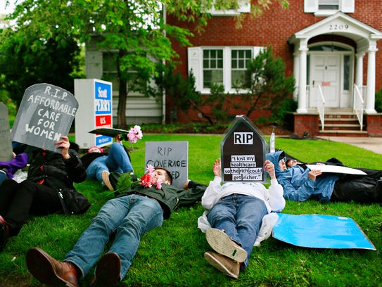 A die-in is staged by anti-Trump demonstrators outside