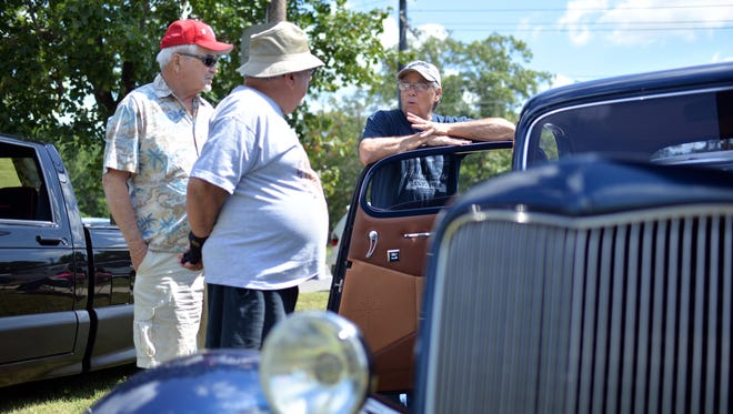 Buddy Kelly, of Centerton, owner of BK Machine in Vineland, talks about his custom 1934 Ford with Sandy Chinnici and Frank Baker, both of Vineland (from right), during the Salute to Our Veterans Car Cruise Sunday at New Jersey Veterans Memorial Home, Aug. 28, 2016 in Vineland.