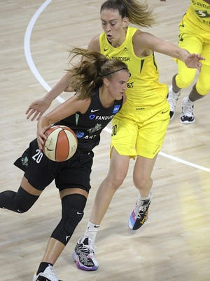 New York Liberty forward Sabrina Ionescu (20) drives past Seattle Storm forward Breanna Stewart (30) during the first half of a WNBA basketball game, Saturday in Ellenton, Fla.