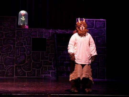 Justin Rohloff as Beast sings during rehearsal of Oshkosh