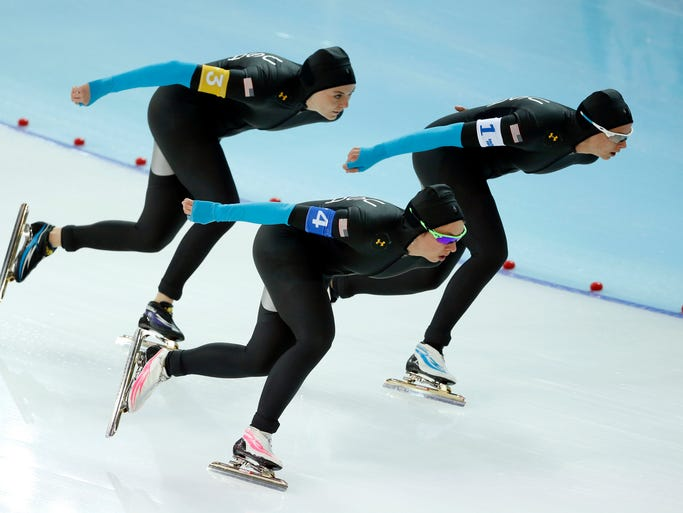 Brittany Bowe (1), Heather Richardson (3), and Jilleanne Rookard (4), all of the USA, skate in the Speed Skating ladies' team pursuit quarterfinals during the Sochi 2014 Olympic Winter Games.