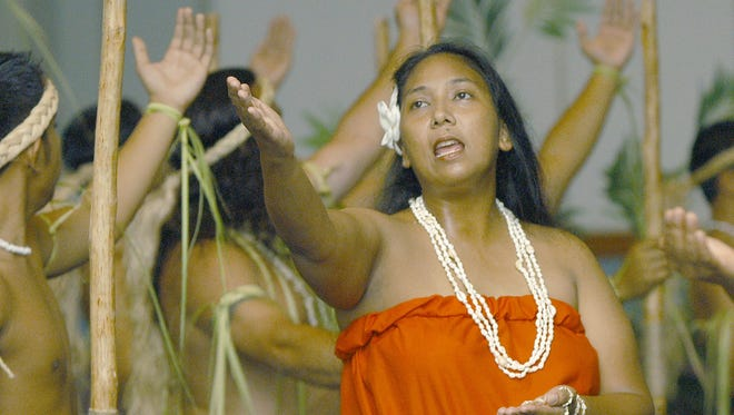 In this 2004 file photo, Agnes Cruz performs along with other cultural performers who participated in an event that helped raise funds for Guam's delegation to attend the ninth Festival of Pacific Arts and Culture in Palau.