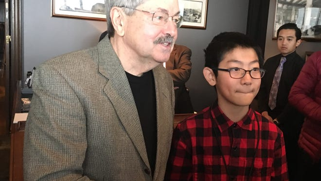 U.S. Ambassador to China Terry Branstad shook hands and posed for a photo on Friday, Dec. 22, 2017, with Kevin Wang, 13, of Beijing, who is currently attending St. Augustin Catholic School in Des Moines. They met at the Iowa-China Business Forum in Des Moines.