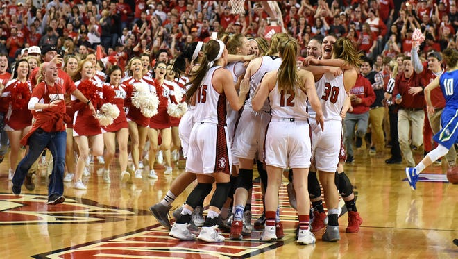 USD celebrates after winning the WNIT championship game against FGCU on Saturday at the DakotaDome in Vermillion.