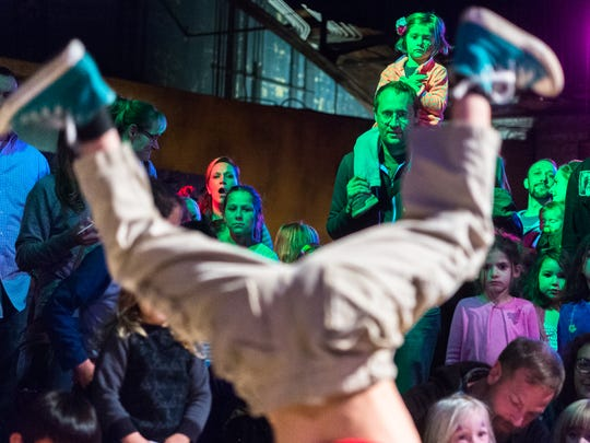 "Micah Honeycutt, of Asheville, watches with his daughter, as kids dance at the Kid hop Hooray wintertime indoor dance party at the Orange Peel, Saturday, November 25, 2017. The event was hosted by The Hop Ice Cream Cafe which hosts dance parties every Wednesday night with local BBoy dancer Joseph ""Joe America"" Adams."