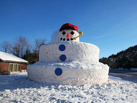 Snowmy Kromer, a 30-foot-tall snowman, stands outside