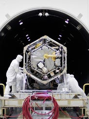 Technicians test NASA's Orbiting Carbon Observatory-2 satellite