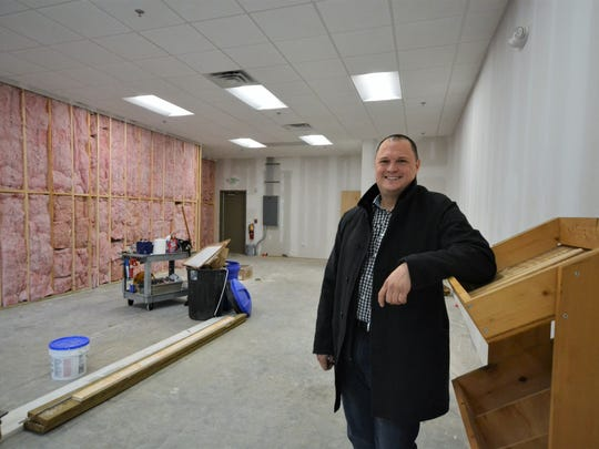 Dan Singletary stands in what will soon be his wine bar's main room at Clemson's Patrick Square development. He and his wife, Theresa, plan to open up Clemson Wine Bar in early 2018.