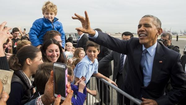 US President Barack Obama greets well wishers upon arrival at Newark Liberty International Airport in Newark, New Jersey, November 2, 2015. Obama is traveling to Newark, New Jersey to speak about the re-entry process for formerly incarcerated individuals and New York City to attend Democratic fundraisers. AFP PHOTO / SAUL LOEBSAUL LOEB/AFP/Getty Images