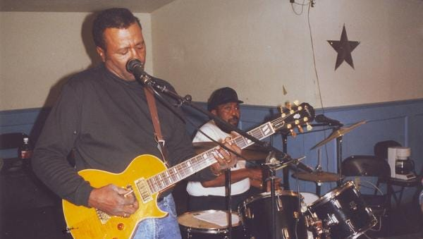 Jonas (left) and James Crudup rehearse at the Gidden's Do-Drop Inn in Weirwood, Va.