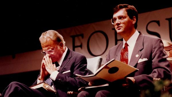 The Rev. Billy Graham prays next to Southern Seminary President Albert Mohler Jr. during last night's service at Freedom Hall. Oct. 14, 1993.  Courier-Journal photo