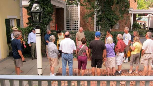 People take a Stockade district tour in the City of Kingston last year. This year's first tour is on May 3.