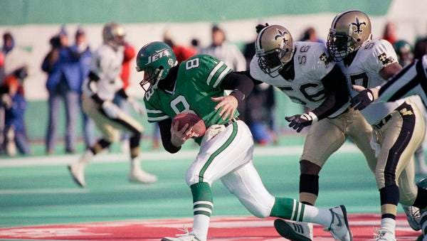 In this Dec. 26, 1992, photo, Jets quarterback Browning Nagle (8) runs away from New Orleans Saints Pat Swilling (56) and Rickey Jackson.