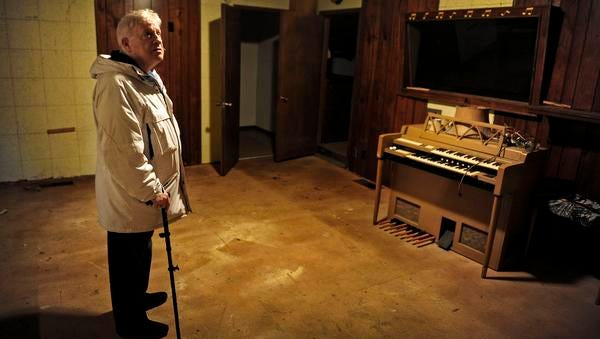 """Jimmie Snow looks around  the recording studio at the home of his father, Hank Snow. He says the organ has been at the """"Rainbow Ranch"""" in Madison since the 1950s."""