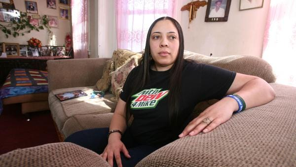 Alexandria Bodden, the sister of Michael Graham, photographed Feb. 27, 2014, in her apartment in the Bronx. Her brother Michael Graham died of a self inflicted gunshot wound from one of his father's illegal guns.