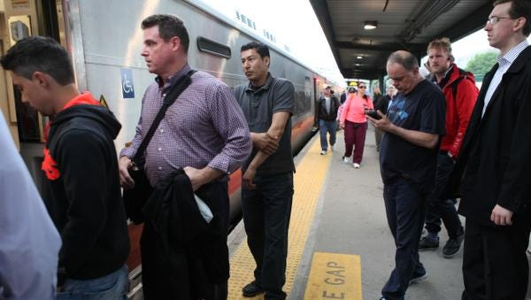 Commuters board a New York City train at the Metro-North Port Chester station May 28, 2014.
