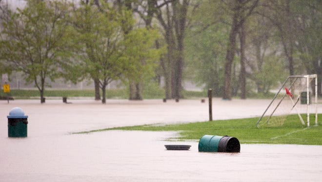 A flooded park at 116th and Cumberland in Fishers, amid flooding due to heavy rains in the region over the weekend, Sunday, April 30, 2017.