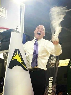 Lipscomb coach Casey Alexander celebrates the Bisons' Atlantic Sun tournament championship win.